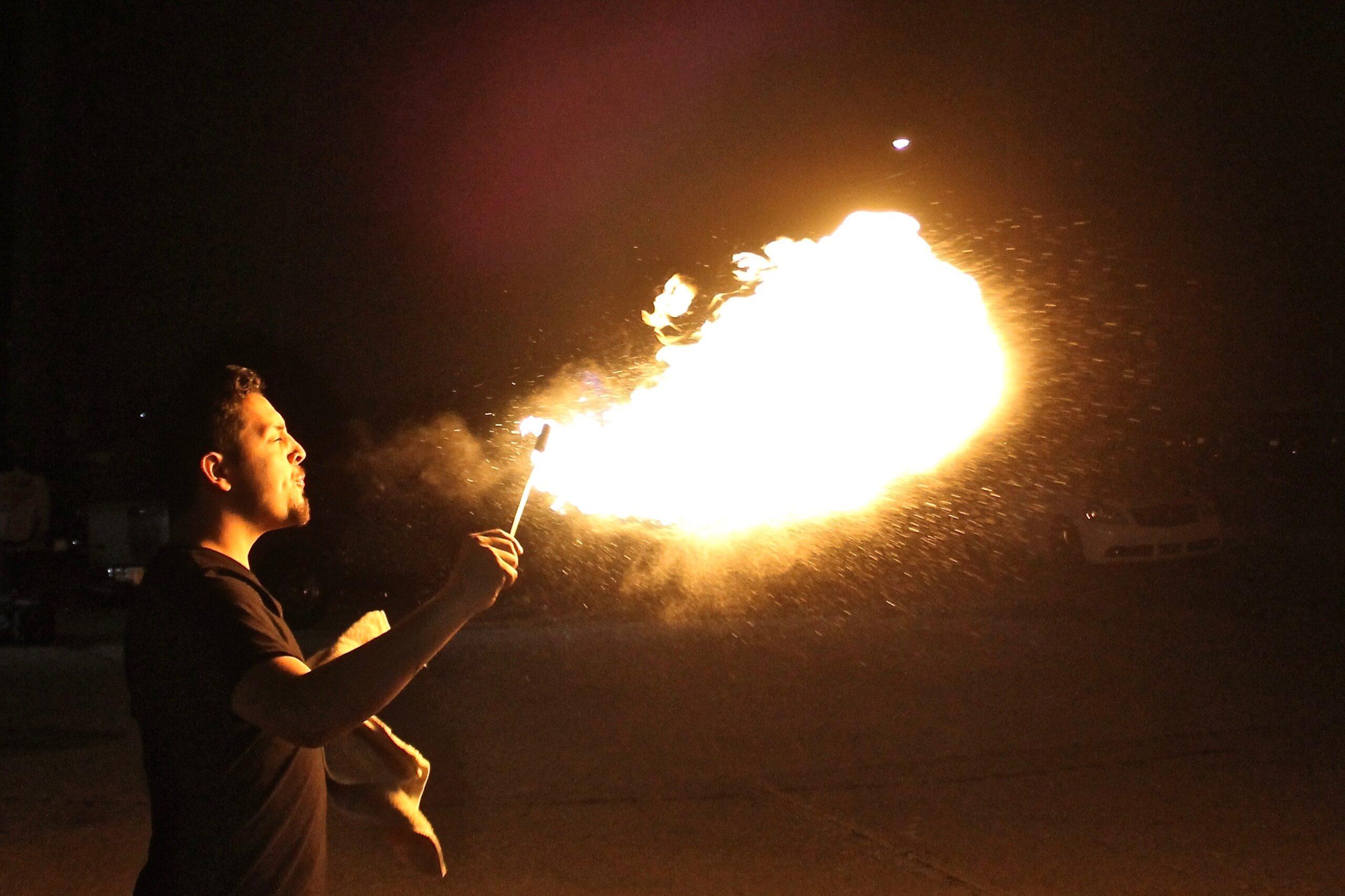 Manuel Garcia breathes fire at the Essex Studios Art Walk